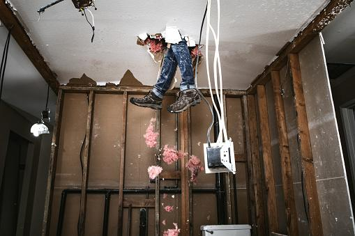 Legs coming through ceiling undergoing repair