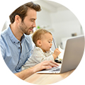father and baby on computer